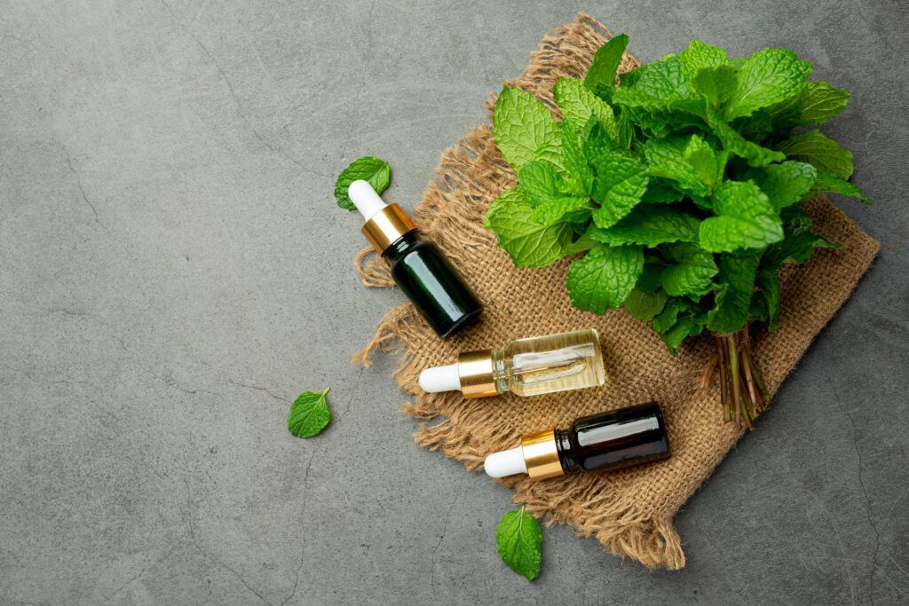 essential-oil-peppermint-bottle-with-fresh-green-peppermint