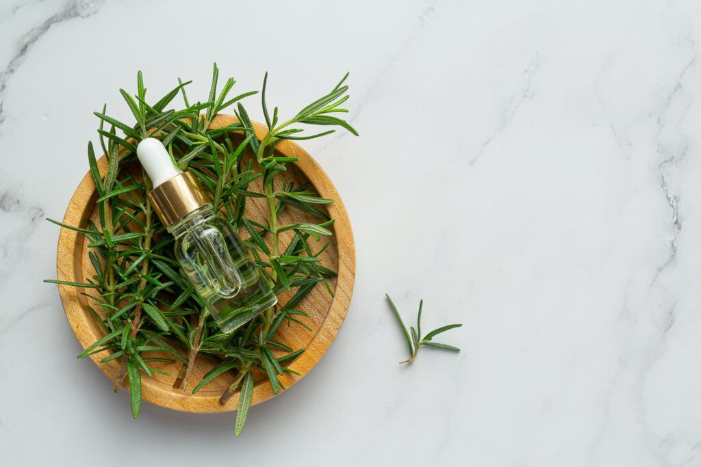 rosemary-oil-bottle-with-rosemary-plants